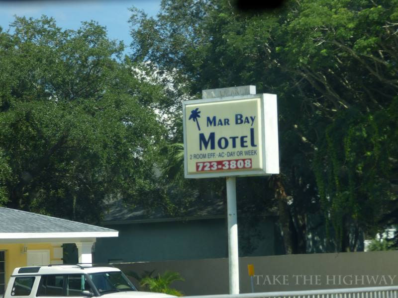 """Mar Bay's sign, with the classic neon """"no vacancy"""" sign on top."""