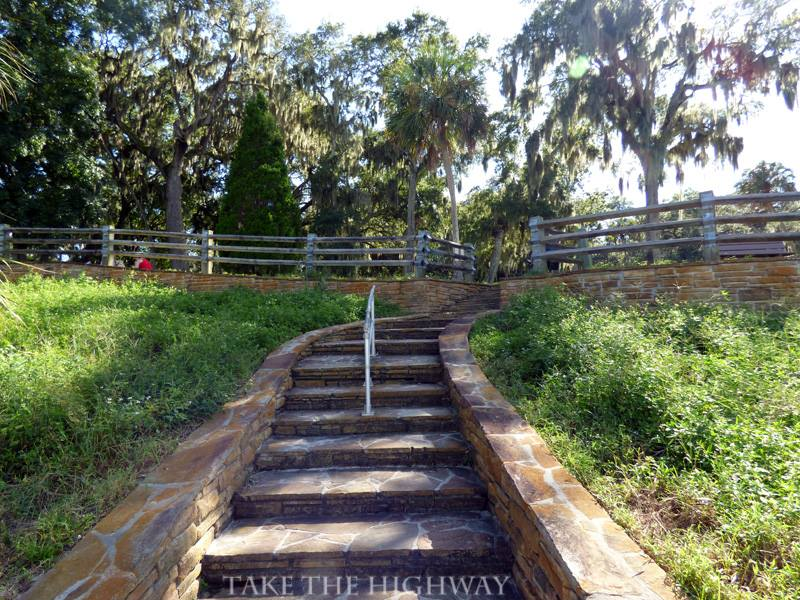 Steps leading from the water towards the mound.
